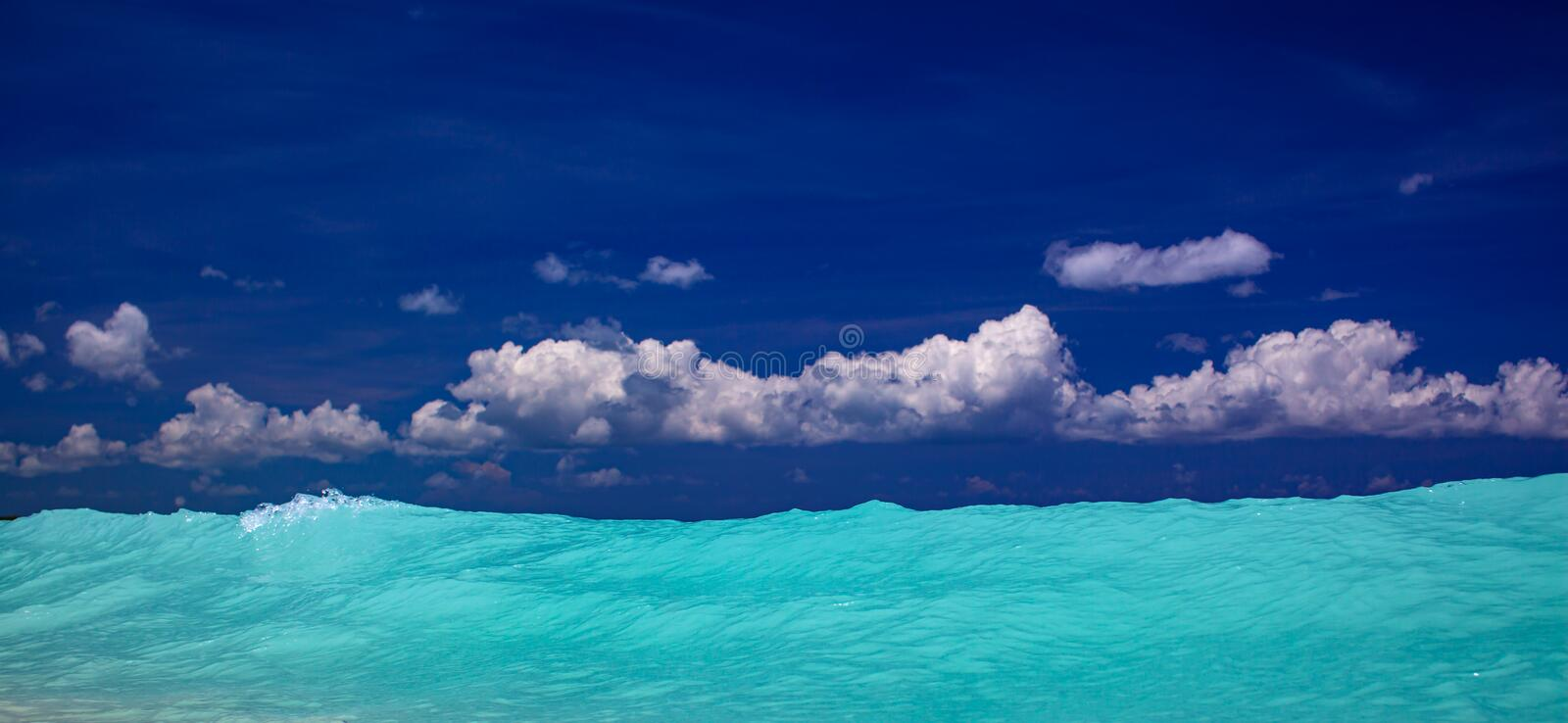Tropical carribean beach with crystal clear water, blue sky and sea royalty free stock image