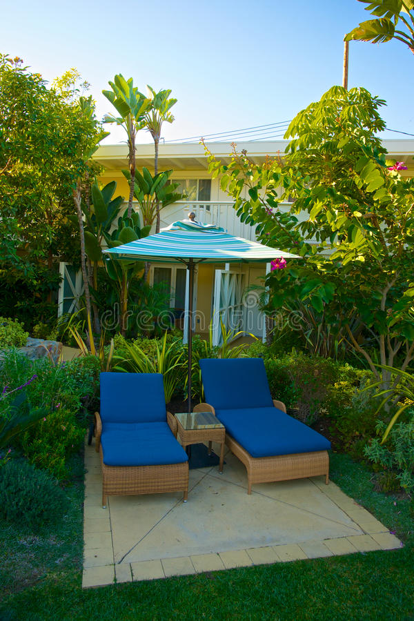 Tropical Chaise Lounge Setting Stock Image