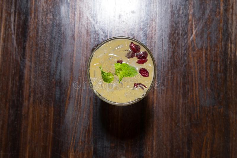 Tropical cocktail with passion fruit, orange and mint on a dark background. Alcoholic cocktail with orange and passion fruit stock photos