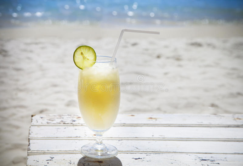 Tropical cocktail with rum on beautiful sunny beach royalty free stock photo