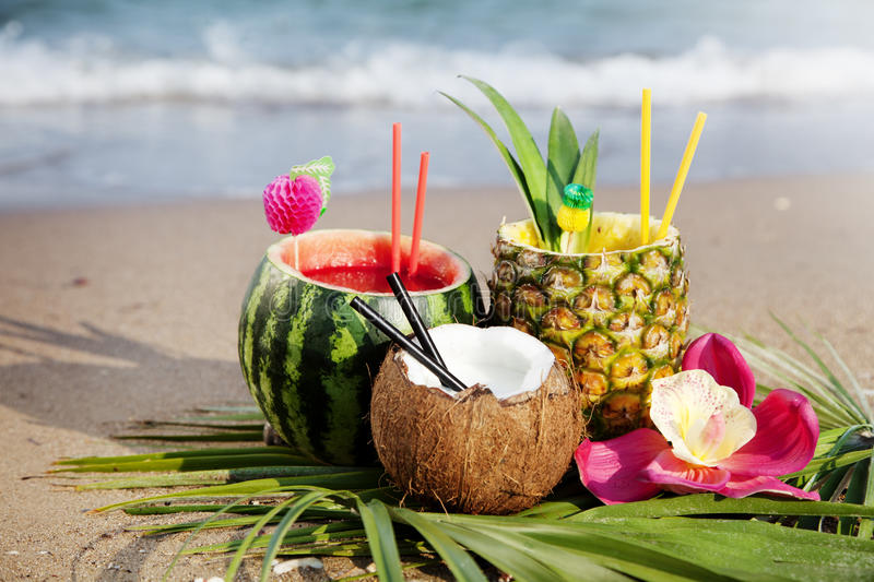 Tropical cocktails. Nice fresh exotic cocktails, served on the beach stock image