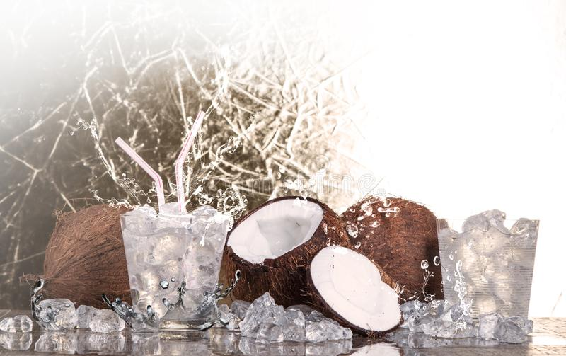 Tropical coconut with ice and splashing wate stock images