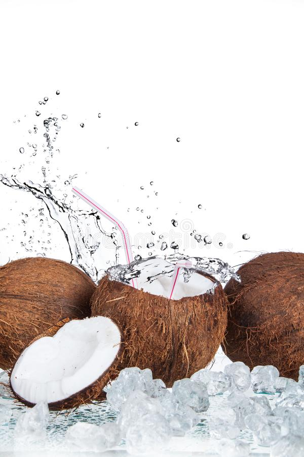 Tropical coconut with ice and splashing wate stock photo