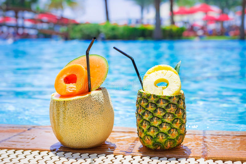 Tropical drinks at the pool royalty free stock images