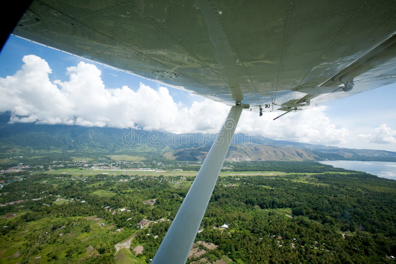 Tropical Flight. An aerieal photo taken from a small airplane - Indonesia royalty free stock photo