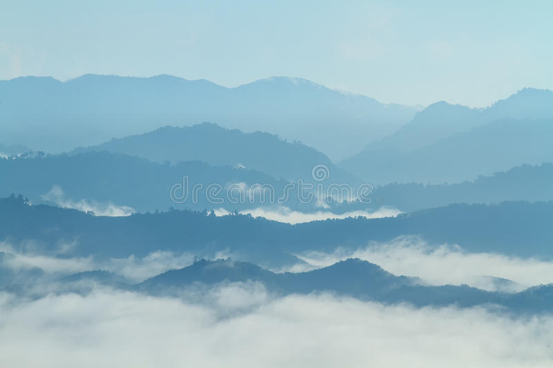 Tropical forest in the morning mountain valley landscape over mist, on Viewpoint Khao Kai Nui, Phang Nga, Thailand. royalty free stock images