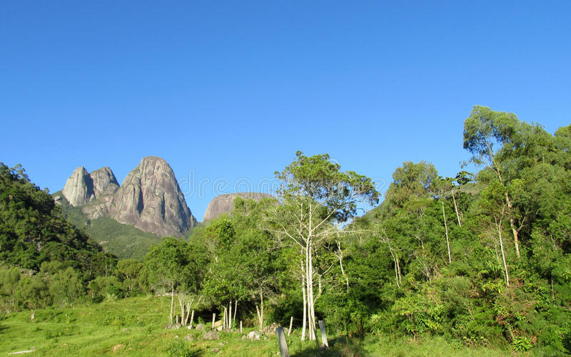 Tropical forest and smooth mountain. Beautiful landscape of green tropical forest and smooth rocks. Tres Picos, three peaks isolate mountain ofSerra dos royalty free stock image