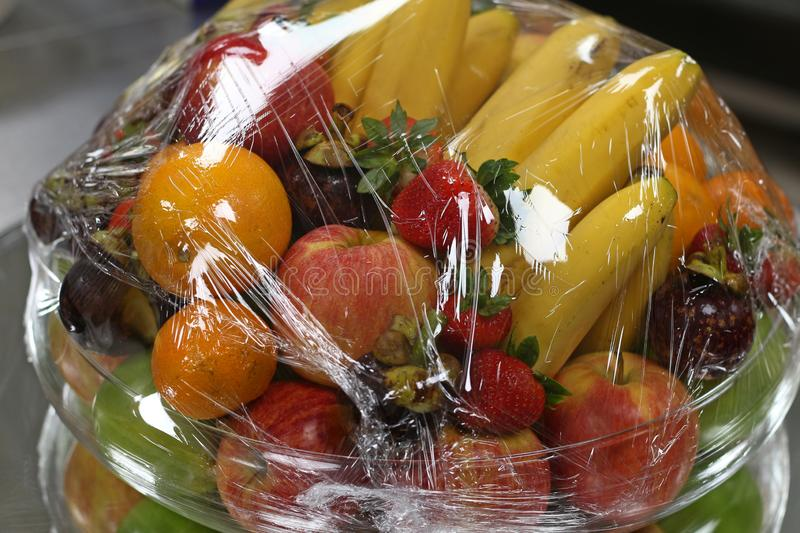 Tropical fresh fruits wraped in plastic stock image