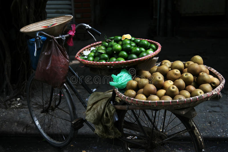 Tropical fruit. Street vendor bicycle with tropical fruit in Hanoi Vietnam