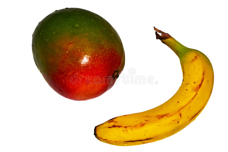 Tropical Fruit Banana And Mango. Isolated With PNG File Attached. A red and green mango and a ripe banana both covered with water droplets. Both separately stock photo