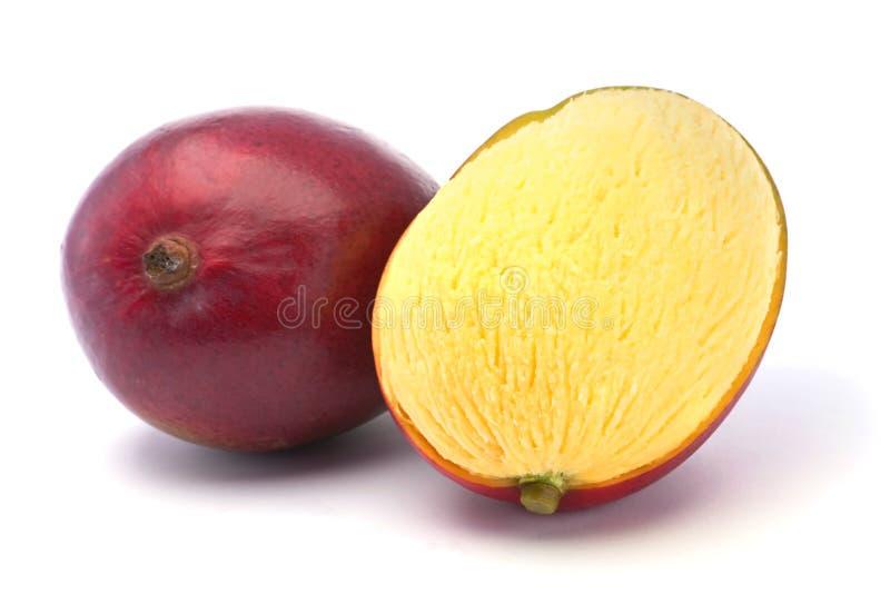 Tropical fruit mango. Tropical fruit ripe mango isolated on white background royalty free stock photography