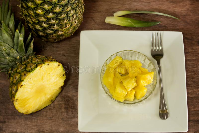 Tropical fruit pineapple from South America. Tropical fruit pineapple - Ananas comosus- piña presented in thin pieces royalty free stock images