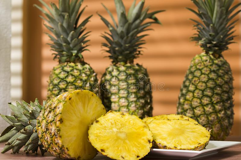 Tropical fruit pineapple from South America. Tropical fruit pineapple - Ananas comosus- split into slices stock photo