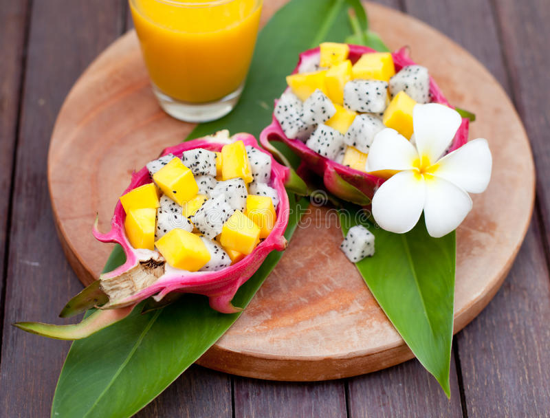 Tropical fruit salad in pitahaya, dragon bowls with mango juice. stock photography