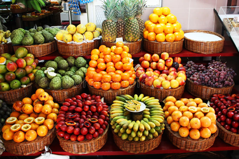 Tropical fruit stand. Colorful fruit stand in a local market stock photos