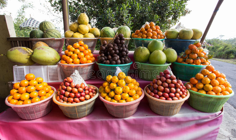 Tropical fruits in baskets on fruit market stock photo
