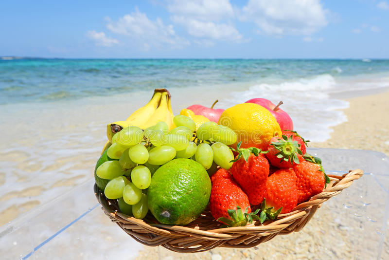 Tropical fruits and the beach royalty free stock photography