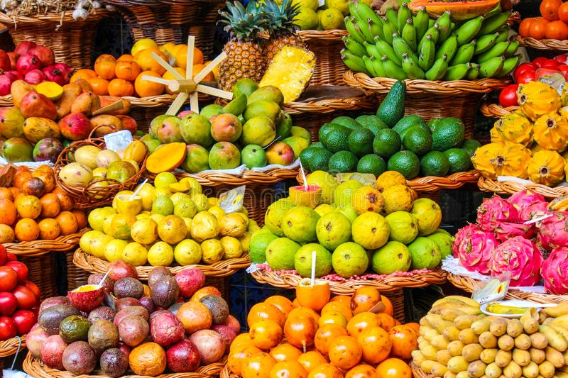 Tropical fruits on the famous market in Funchal, Madeira Island, Portugal. Exotic fruit. Banana, mango, passion fruit or avocado. royalty free stock photos