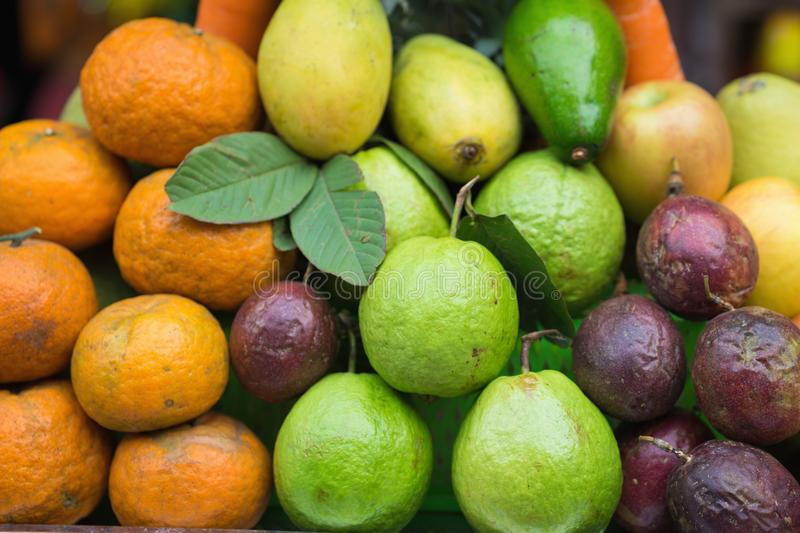 Tropical fruits with guava, orange, passion fruit, mango, apple royalty free stock image