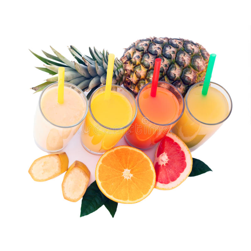 Tropical fruits and juice isolated on white stock photography