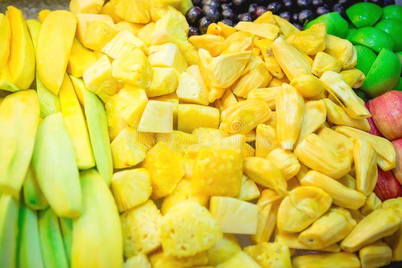 Tropical fruits in the market. Mango, pineapple, jackfruit and apple. Tropical fruits in the market. Mango, pineapple, jackfruit stock photography