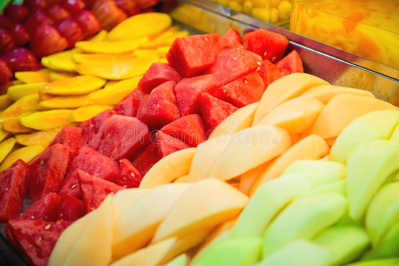 Tropical fruits at the market. Watermelon, papaya, mango and melon. Tropical fruits at the market. Watermelon, papaya, mango royalty free stock image