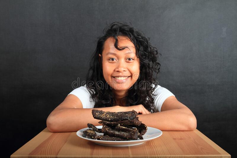 Girl with beef biltong - African dried meet stock image