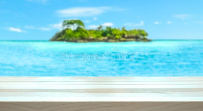 Tropical holiday concept. Paradise island and ocean blurred in the background stock photography
