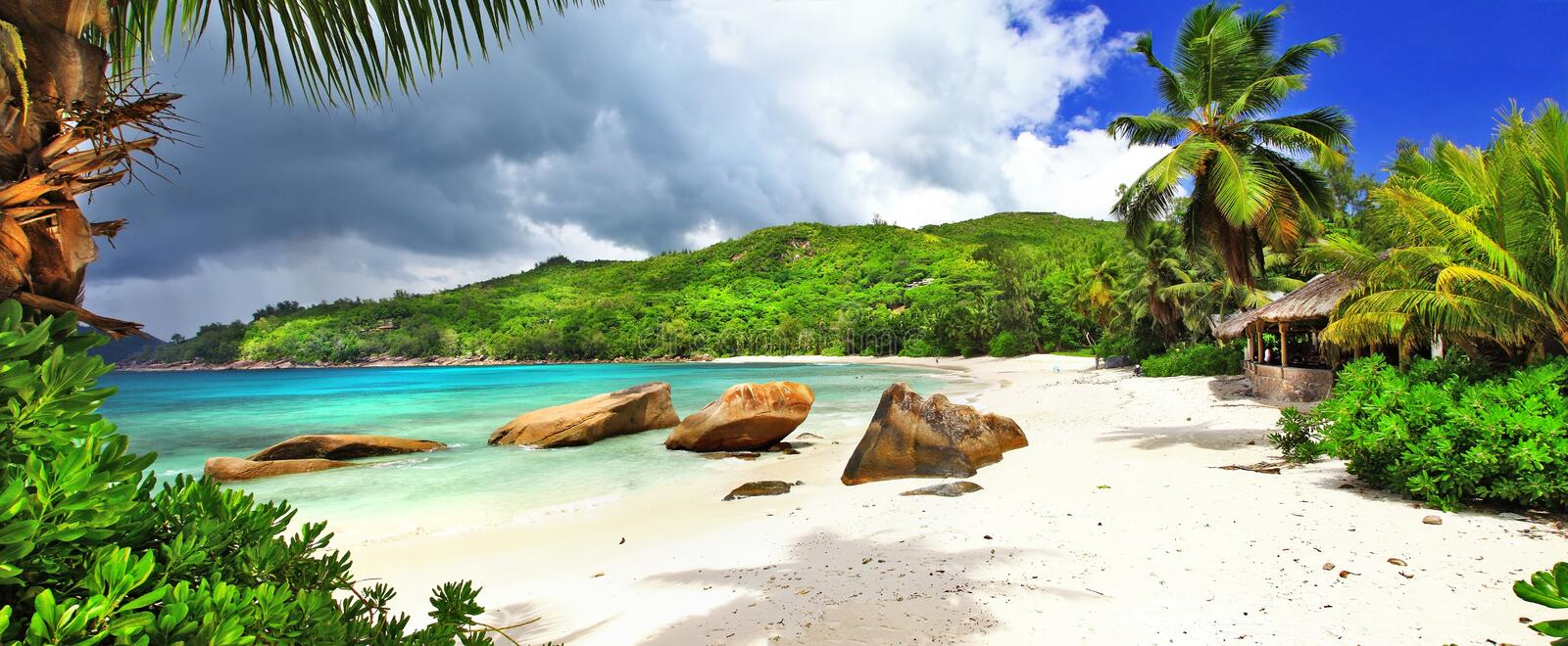 Tropical holidays in Seychelles. Panoramic view of Takamaka bay royalty free stock photos