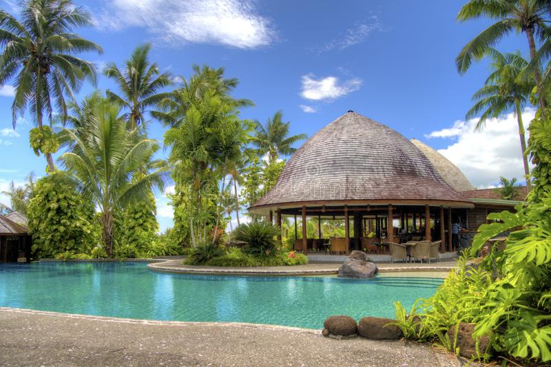 Tropical hotel swimming pool royalty free stock images