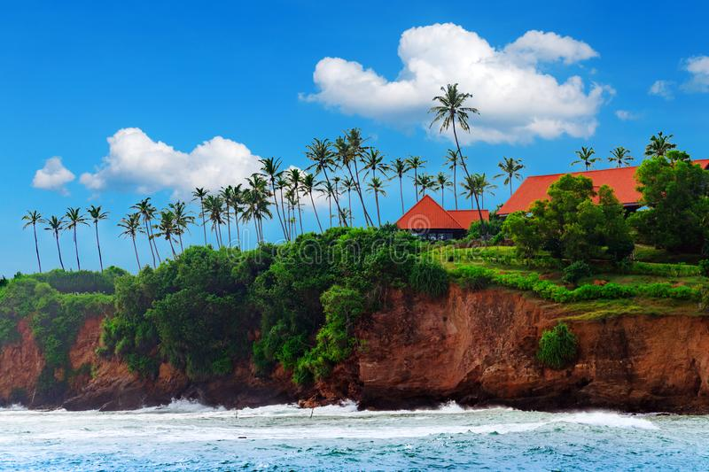 Tropical island, house cliff among palm trees. Tropical life. Sri Lanka landscape. Summer holidays at ocean beach. Beautiful day, beach resort in tropics stock photography