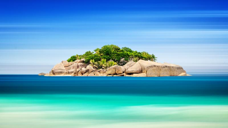 Tropical island in ocean - vacation background, Long exposure, blur motion, Seychelles stock photos