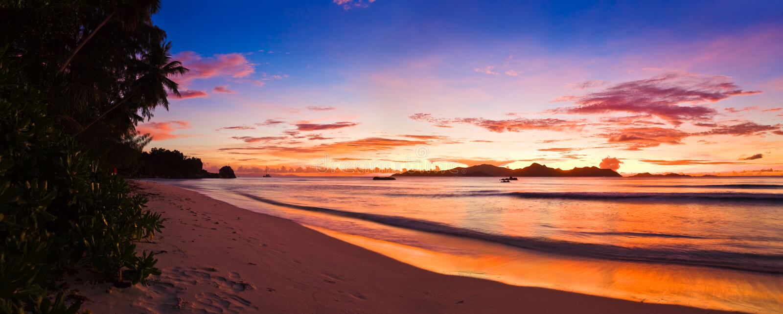 Tropical island at sunset royalty free stock photo