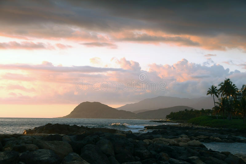 Tropical island sunset, Oahu, Hawaii royalty free stock image