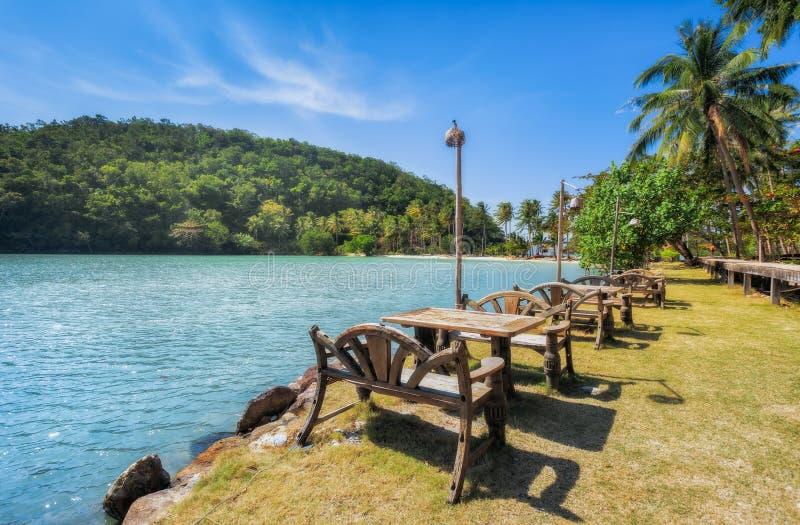 Tropical island, tables on the beach. Thailand Koh Ngam. Tropical island of Koh Ngam in the Gulf of Thailand stock image