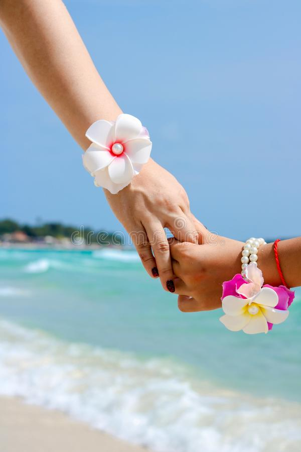 Beautiful young couple hand in hand stock photo