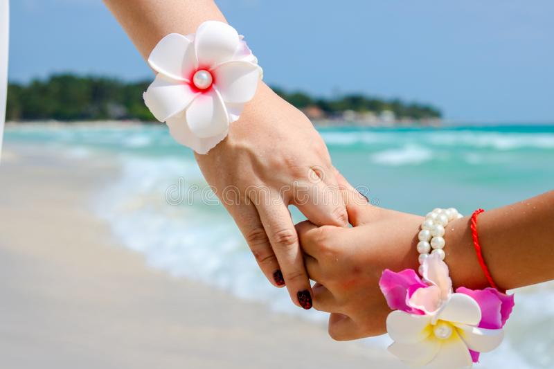 Beautiful young couple hand in hand royalty free stock photos