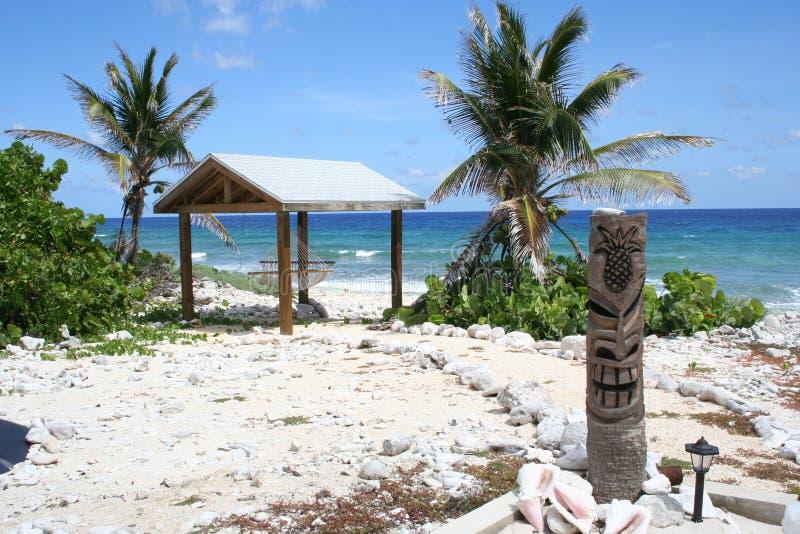 Tropical Island Beach Hut: Tropical Island Tiki Hut Ocean View Scene Stock Photo