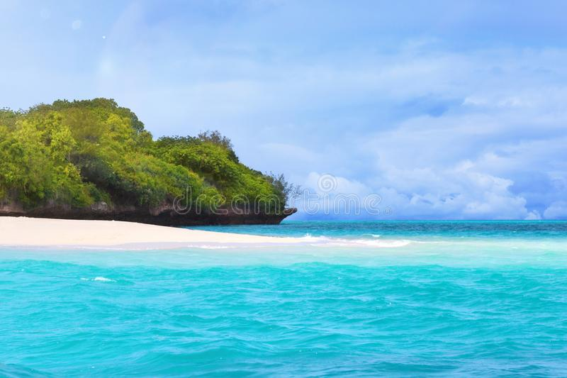 Tropical island and turquoise ocean stock photography