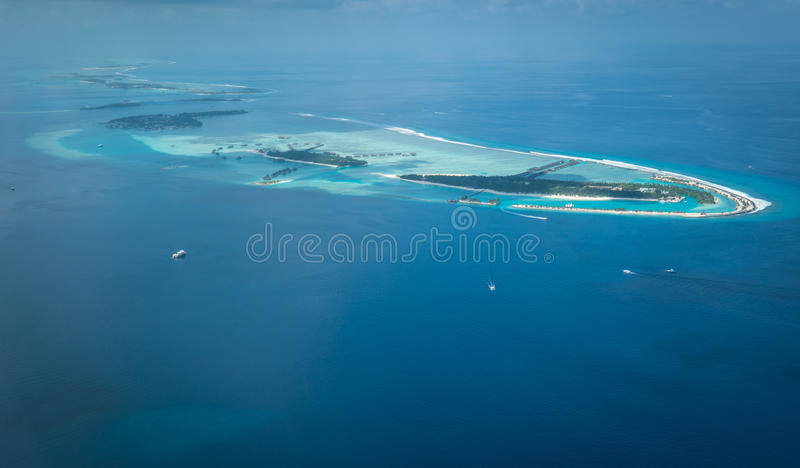 Tropical islands and atolls in Maldives from aerial view royalty free stock photography
