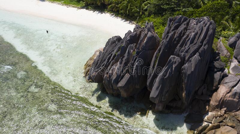 Aerial shooting in tropical regions of the planet. Seyshelles. Tropical islands and beaches. Shooting from the drone. Pure turquoise waters of the ocean. White stock photos