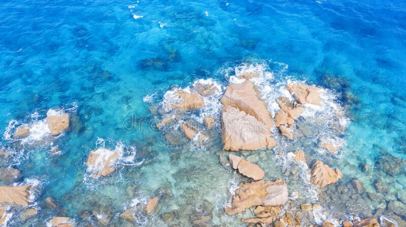 Aerial shooting in tropical regions of the planet. Seyshelles. Tropical islands and beaches. Shooting from the drone. Pure turquoise waters of the ocean. White stock photo