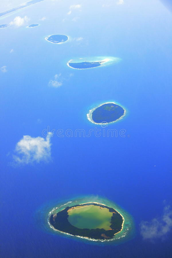 Tropical islands in Maldives. The famous destination for honeymooners and divers. photo taken from an airplane royalty free stock photography