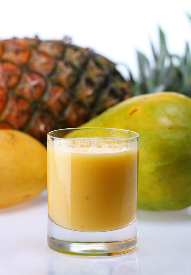 Tropical juice. Fruit blend juice in glass stock photography