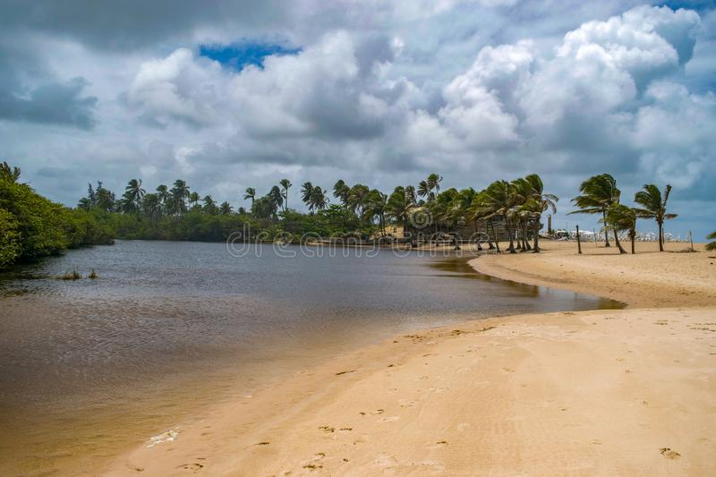 Tropical lagoon by the empty beach of the north of brasil before the storm. Tropical empty beach of the north of brasil before the storm. The sky is cloudy and stock photography