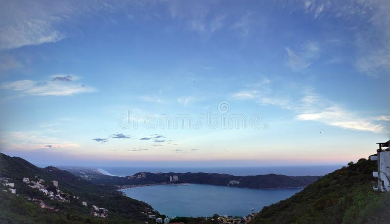 Tropical landscape in the bay of Puerto Marques in Acapulco, Mexico at sunset. Travel, tourism, vacation, view, sky, sea, ocean, horizon stock photo
