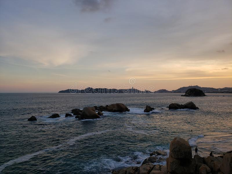 Tropical landscape in the main bay of Acapulco, Mexico during sunset. Travel, tourism, vacation, water, sea, ocean, mexican, beach, coast, sky, evening, dusk royalty free stock photos