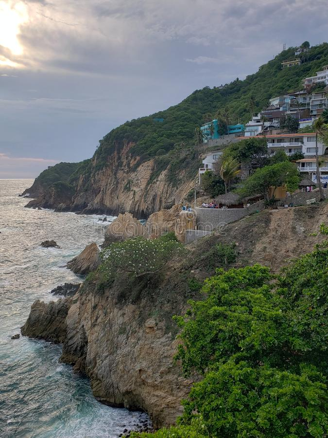 Tropical landscape in the traditional area of ​​Acapulco, Mexico. Mexican, sea, ocean, water, saltwater, travel, tourism, vacation, rock, stone stock photo