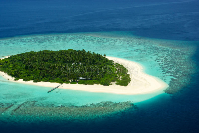 Tropical Maldivian island from above. Ocean royalty free stock image