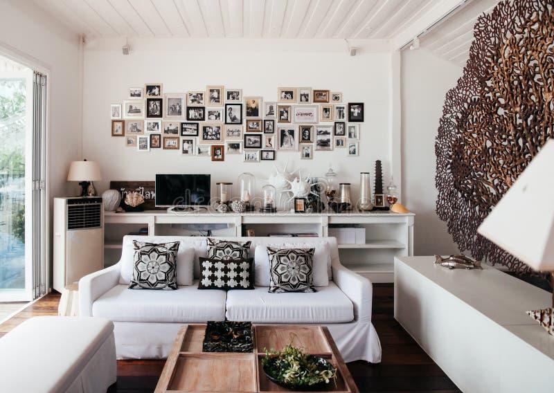 Tropical modern beach house white tone living room interior stock photos